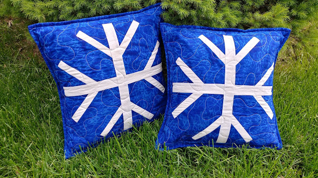 Snowfall snowflake quilted pillows