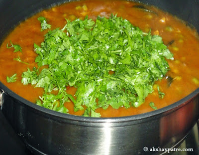 cilantro added to pav bhaji