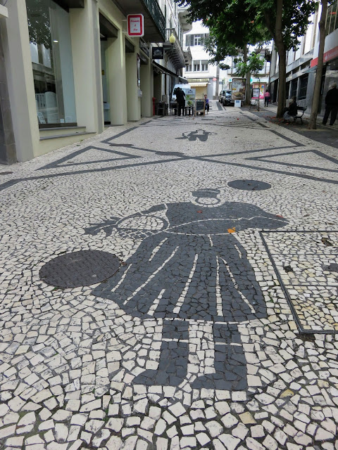 Patterned mosaic stone street in Funchal, Madeira