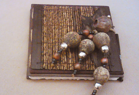 Gum Nuts and Silver Beads with sticks and wood beads on this lovely journal