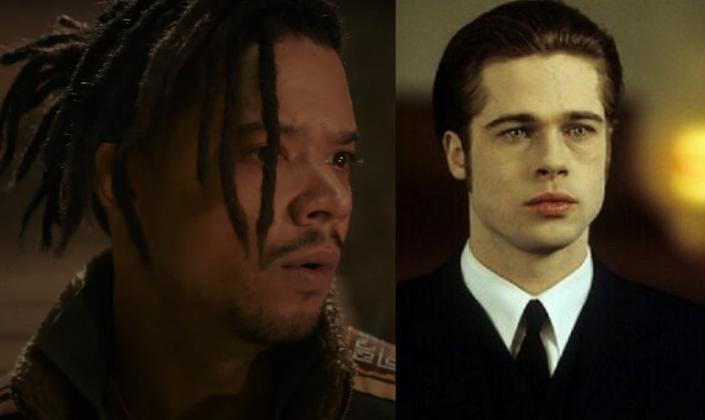 Imagem: na esquerda o ator Jacob Anderson, um homem negro, magro com dreads longos, olhos castanhos, barba curta, em um tipo de casaco e ao lado o vampiro Louis, interpretado por Brad Pitt, um homem pálido com olhos foscos e longos cabelos amarrados num rabo de cavalo e de terno preto.