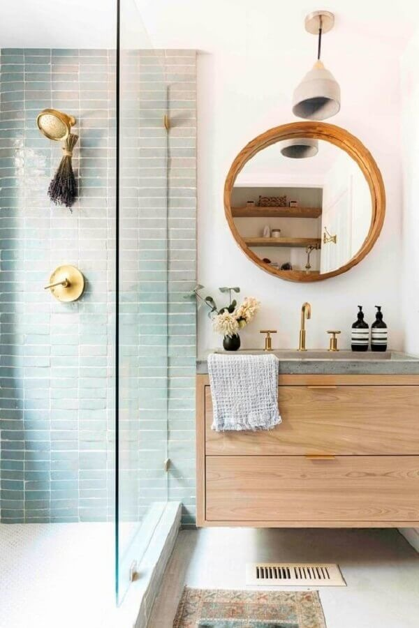 Decoration with suspended cabinet and round bathroom mirror with wooden frame