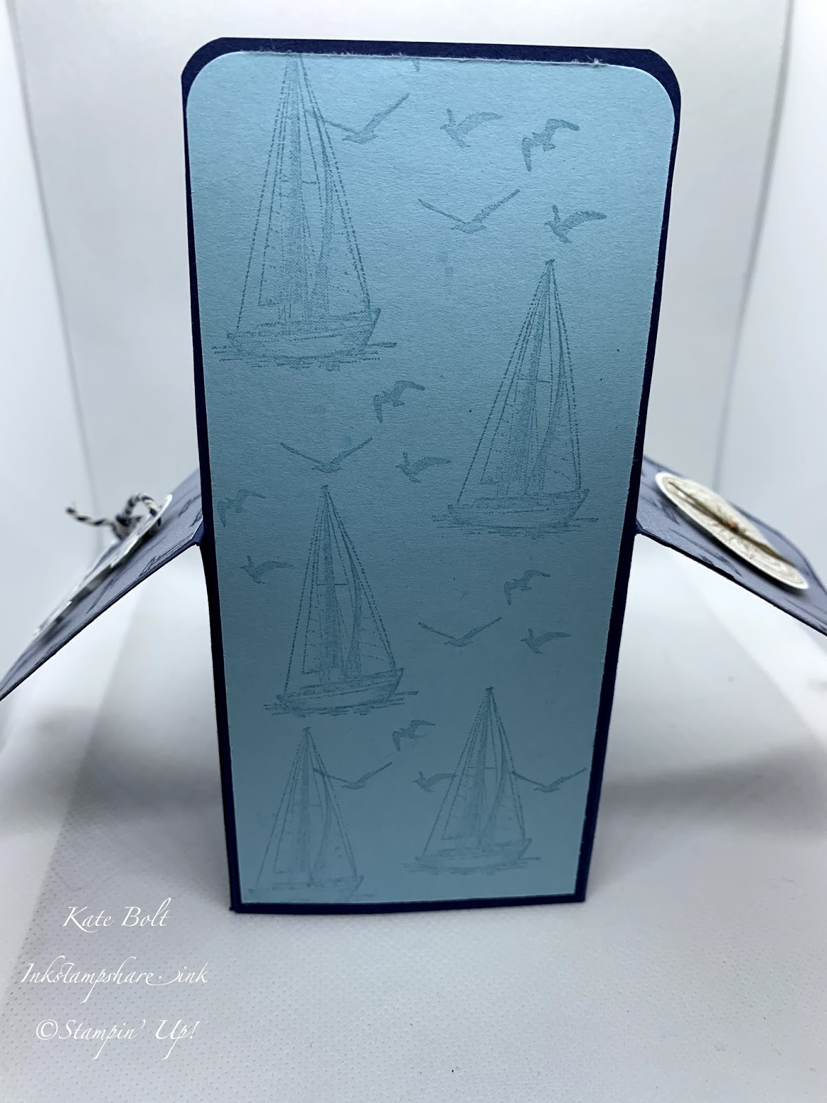 This is the back view of a  card in a box with boats, light house, anchor, compass and seaweed, using the Lets Sail Away stamps, dies and paper from Stampin Up