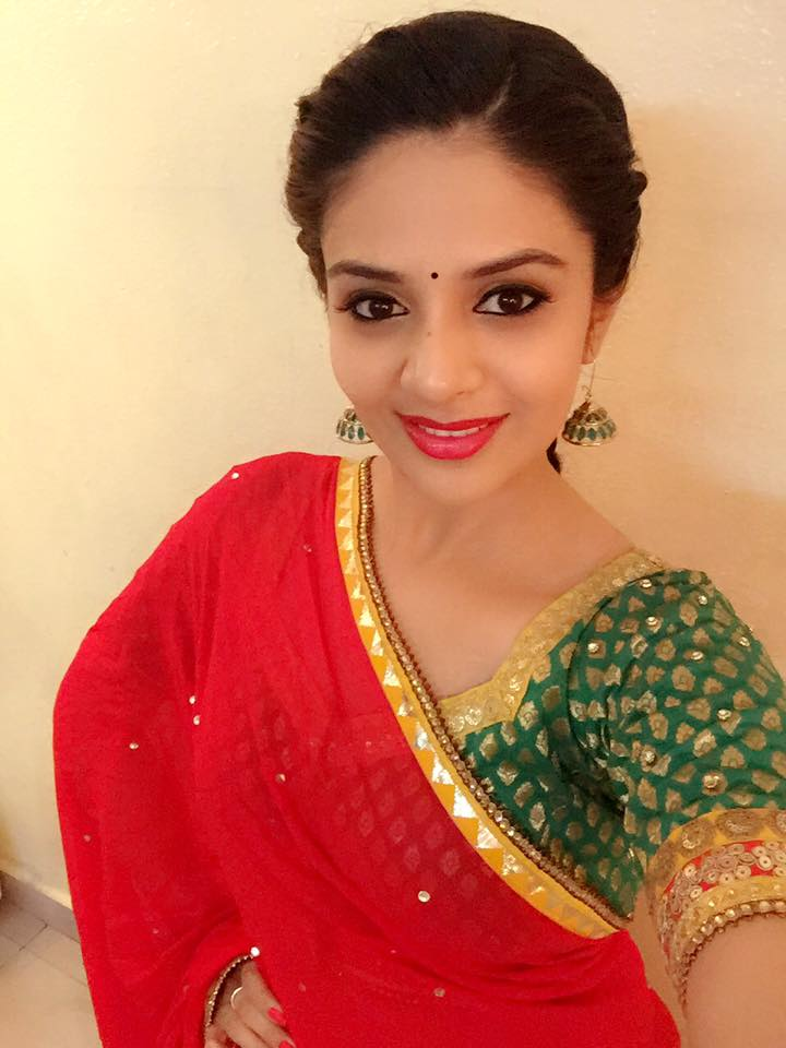 Tv Anchor Sreemukhi Long Hair In Red Half Saree