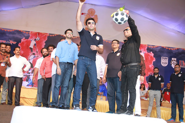Pic 3-  Ranbir Kapoor, Co-owner, Mumbai City FC, showing the auspicious coconut to the audience along as he prepares to break the auspicious football themed Dahi Handi on Janmashtami, with Aditya Thackeray, Head of Yuva Sena and Bimal Parekh, Team Owner, Mumbai City FC.