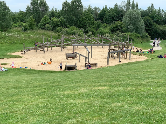 Sand pit with wooden play frames at Great Notley Park near braintree in Essex