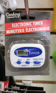 Cooking Concepts Digital Timer in packaging hanging on a peghook at a Dollar Tree store