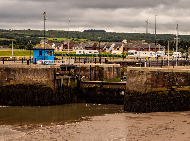 Photo of Maryport Marina sea gate closed and holding water in the marina at low tide