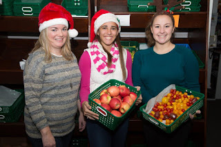 left to right, are Erin Lynch, Pantry executive director, and Lead Food Elves Ellie Teixeira and Julia Buccella. Photo courtesy of Bob Teixeira