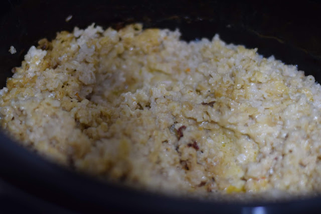 The fully cooked chicken and rice in the crockpot.
