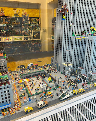 Lego store window with diorama of Rockefeller Center