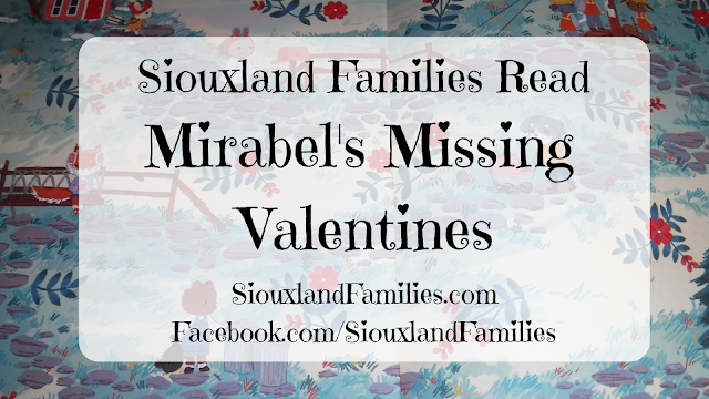 """in background, picture of inside cover of Mirabel's Missing Valentines, a minty green scene with red flowers and cute woodland creatures. in foreground, the words """"Siouxland Families Read Mirabel's Missing Valentines"""""""