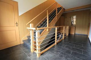 Treppenrenovierung - Brüstung mit Edelstahl Traversen