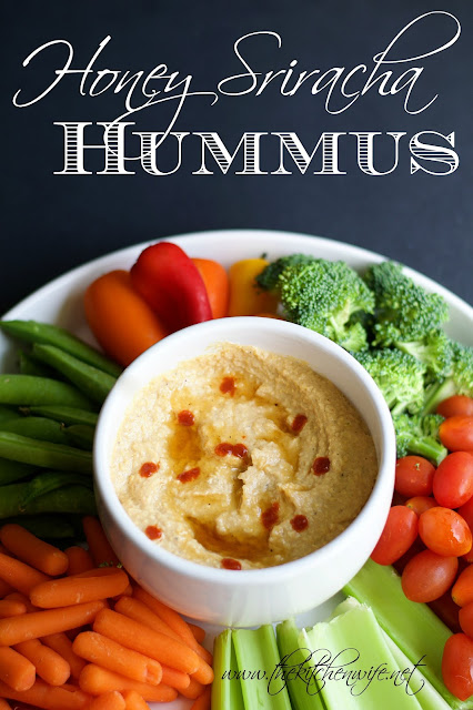 The honey sriracha hummus in a dish surrounded by vegetables with the title above it.