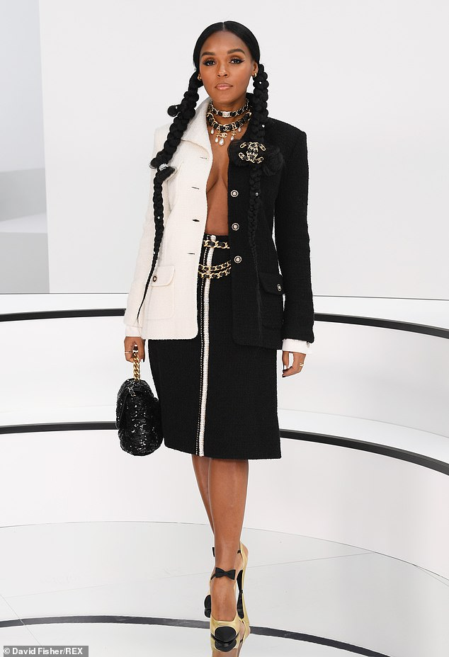 Janelle Monae opts for a daring take on the classic Chanel suit as she goes braless in the monochrome ensemble at the brand's PFW show