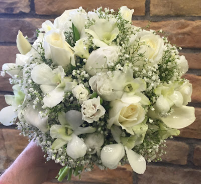 Traditional white bridal clutch bouquet by Stein Your Florist Co.