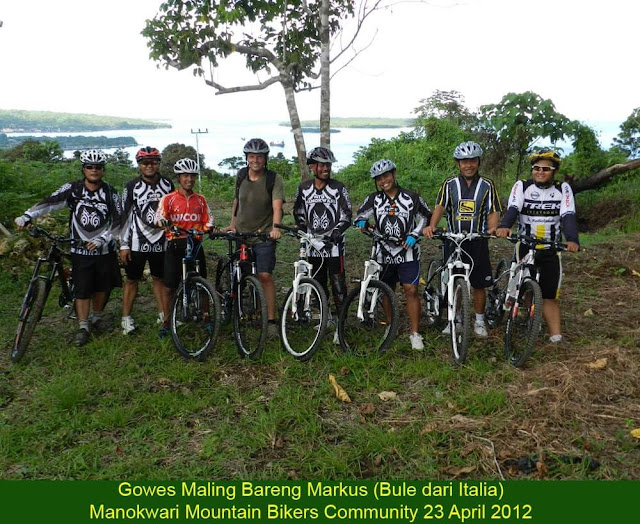 Mountain Bike Community in Manokwari with Italian tourist Marcus Lageder was posing for a picture with Dore bay as the background