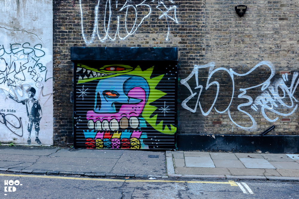 UK Street Artist Sweet Toof skulls with a crocodile by artist Rowdy
