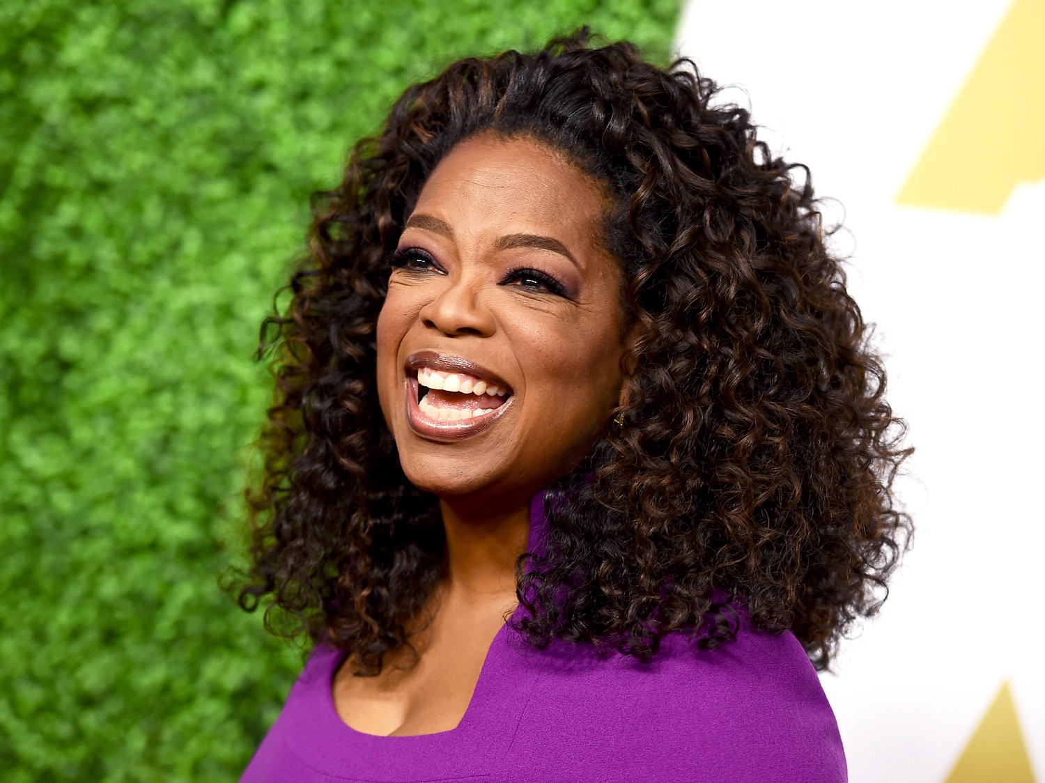 Oprah Always smiles