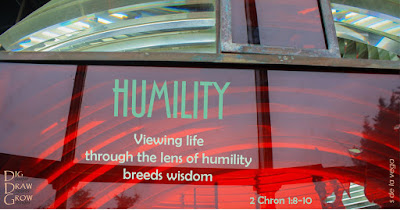 "Lighthouse lens displaying caption ""Humility: Viewing life through the lens of humility breeds wisdom"""
