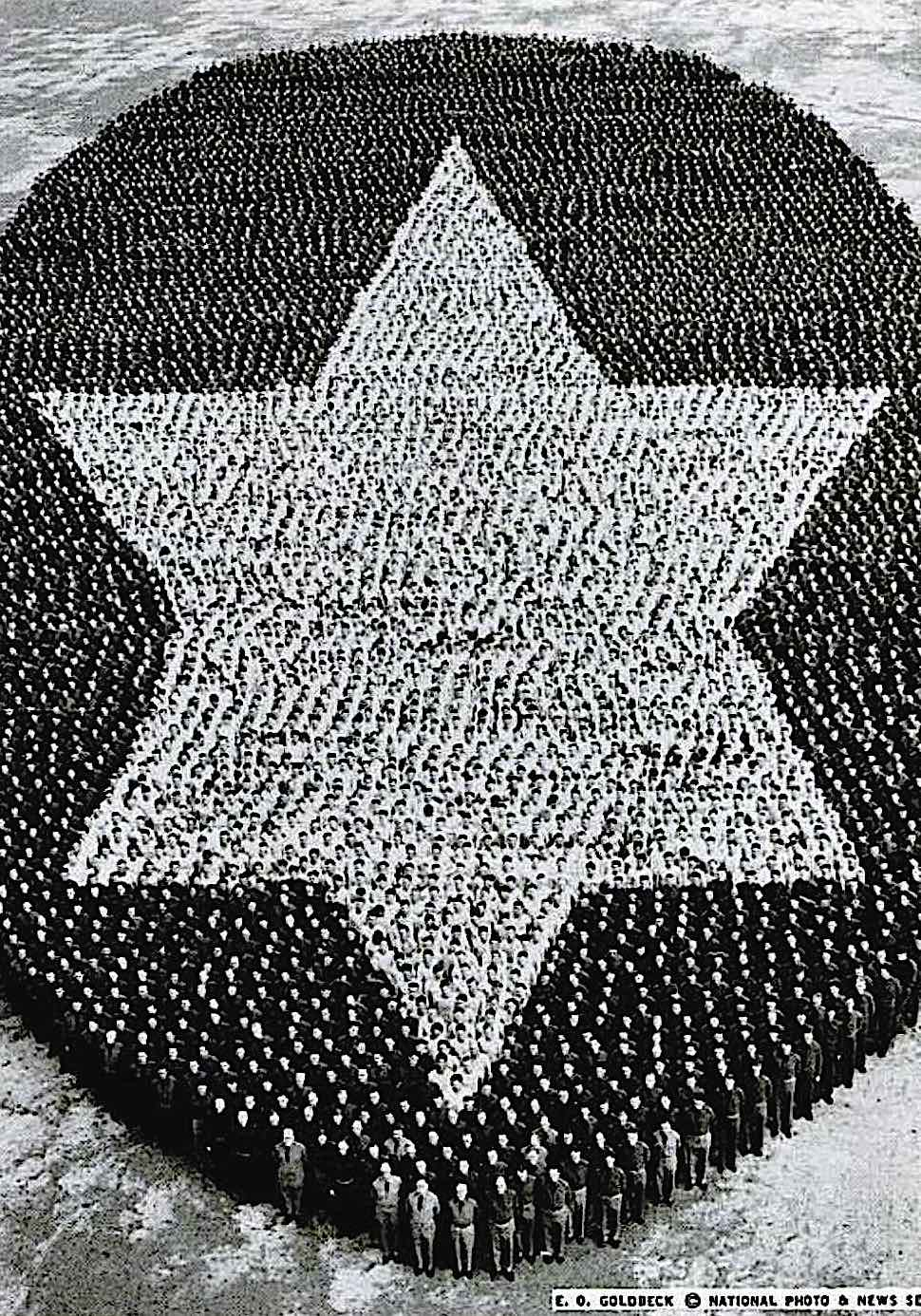 1940 USA troops at attention in a giant star, a group aerial photograph