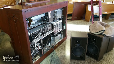 Rear view of Allen organ and HR-100 speakers during installation