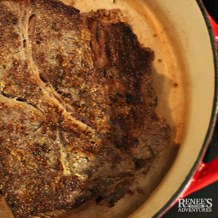 Process photo of Dutch Oven Pot Roast by Renee's Kitchen Adventures chuck roast is seasoned and seared on all side in dutch oven