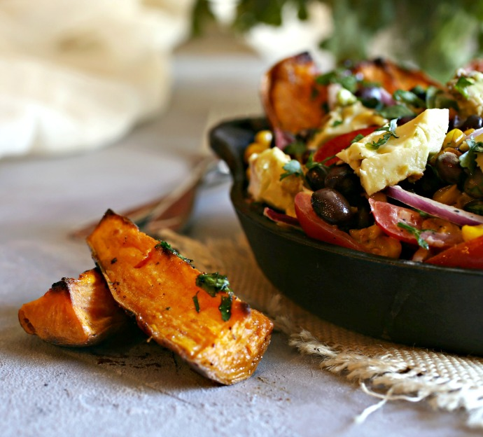 Recipe for a bean salad with tomatoes, corn, avocado and roasted sweet potato wedges.