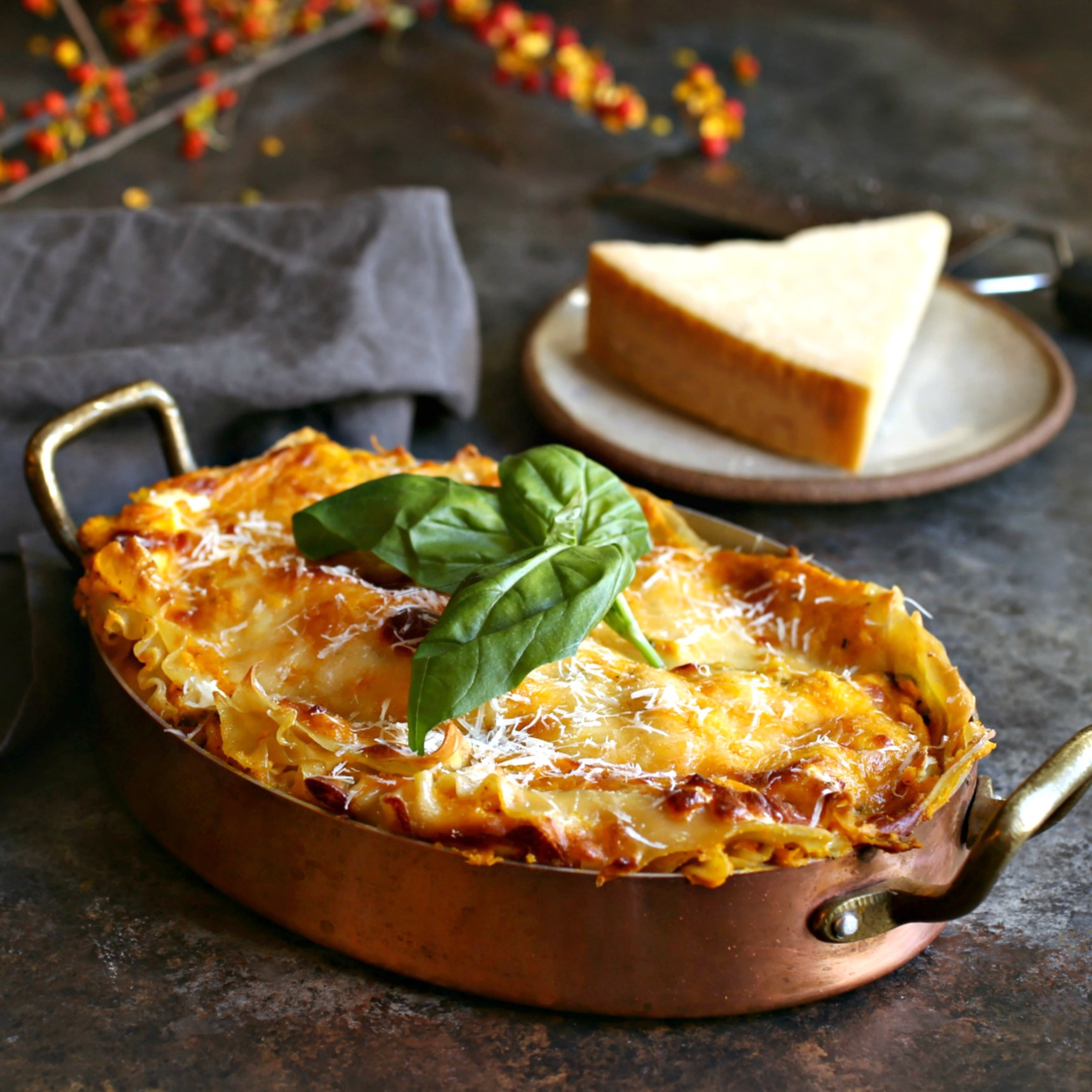 Recipe for lasagna made with a creamy butternut squash and Parmesan bechamel sauce.