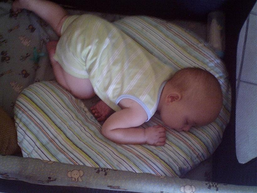 Exhausted Baby Sleeping on Boppy Pillow