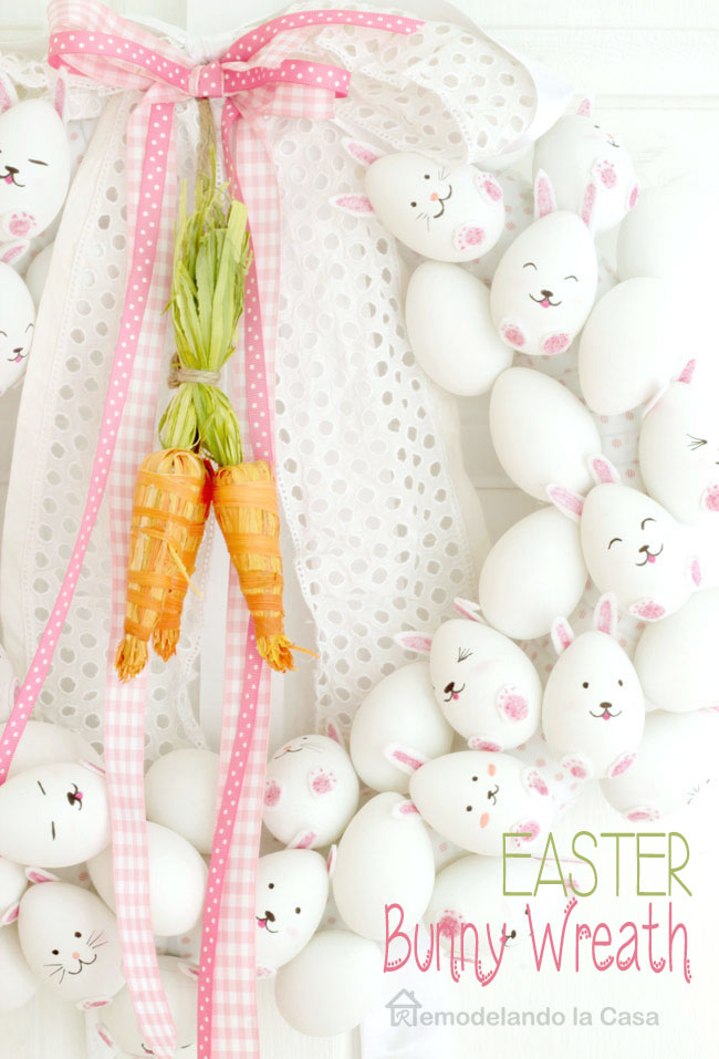 white eggs turned into bunnies on a wreath form decorating the main door