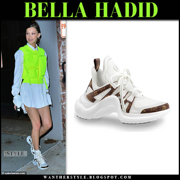 Bella Hadid in neon yellow vest, white shirt and sneakers louis vuitton archlight model style januay 9