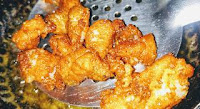 Deep frying Bombay duck for bombil fish fry recipe