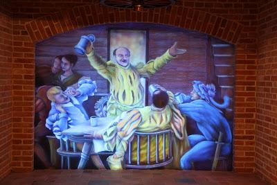 Malowanie obrazu na ścianie w ultrafiolecie, aranżacja ściany w pubie poprzez malowanie ścienne.