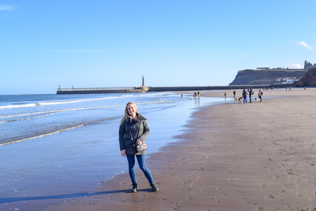 Walking Whitby to Sandsend - standing on Whitby beach in front of lighthouse