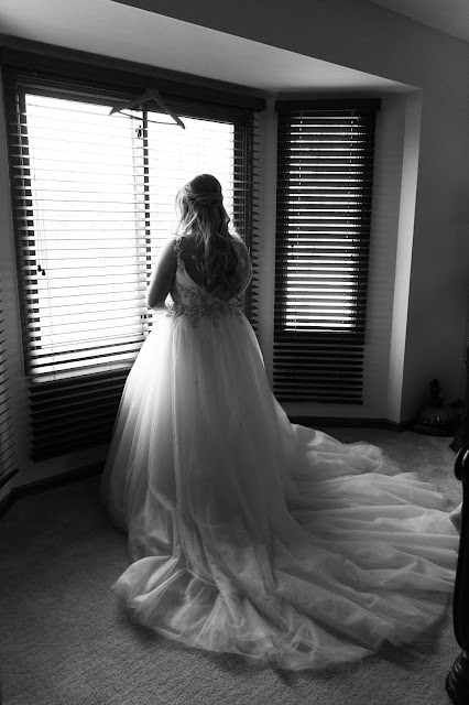 bride wearing a beautiful wedding dress from Arena Bridal shop