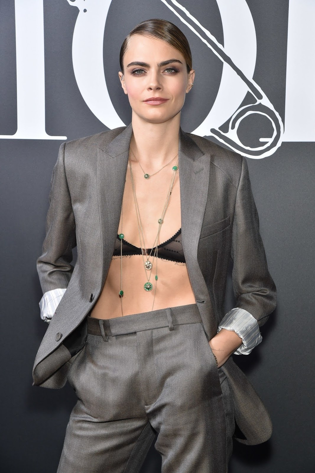 Cara Delevingne arrives at the Dior Homme Fashion Show in Paris in sheer Fenty bra
