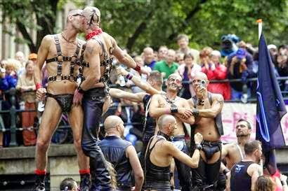 Gay men kissing on a parade
