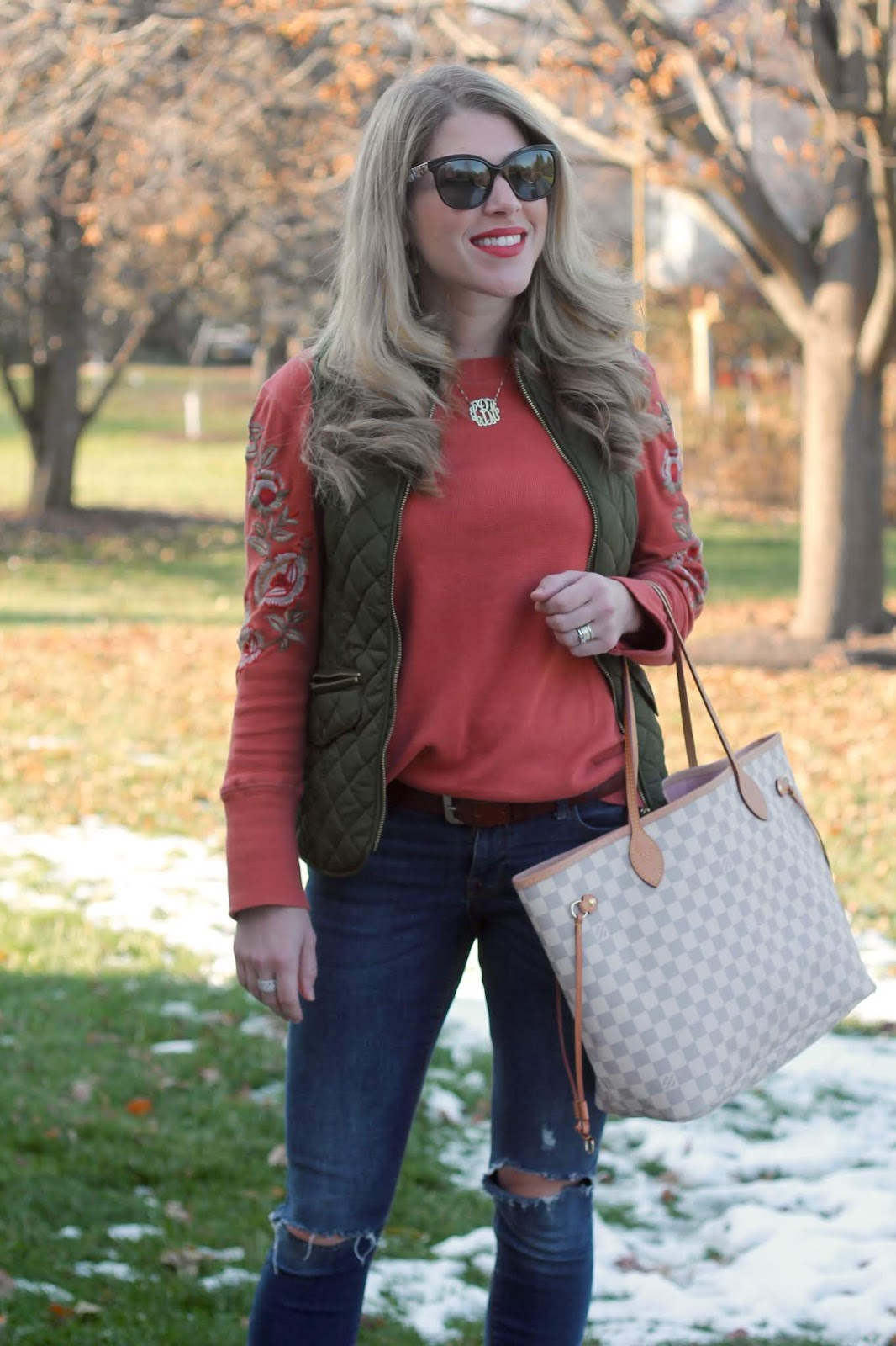 cait & Kyla orange embroidered top, olive quilted vest, distressed rockstar jeans, cognac booties, LV azure neverfull