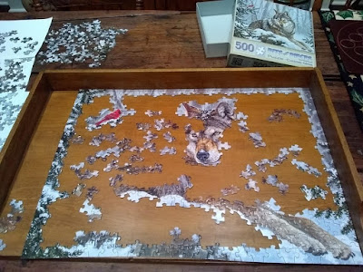 Jogsaw puzzle pieces laid out on table
