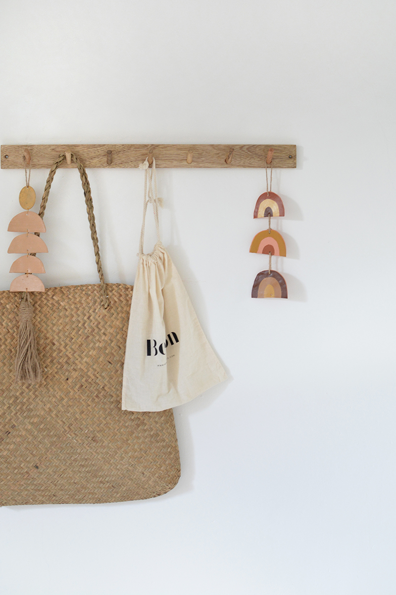 boho wooden peg rail in nursery