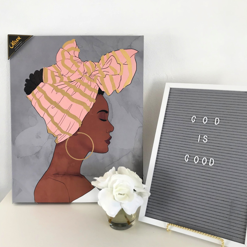 a painting with an African american women in a head wrap