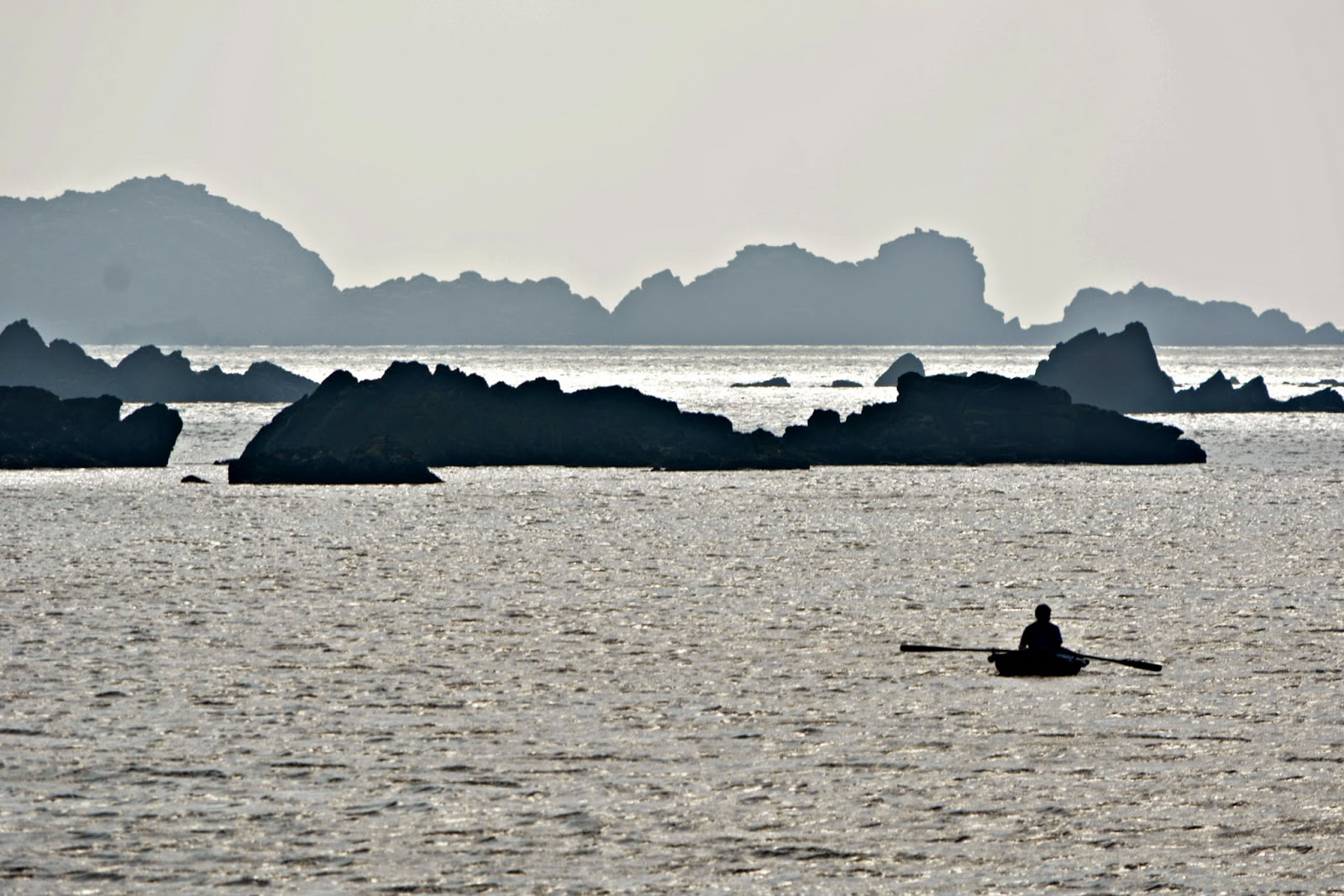Man in a rowing boat Isles of Scilly