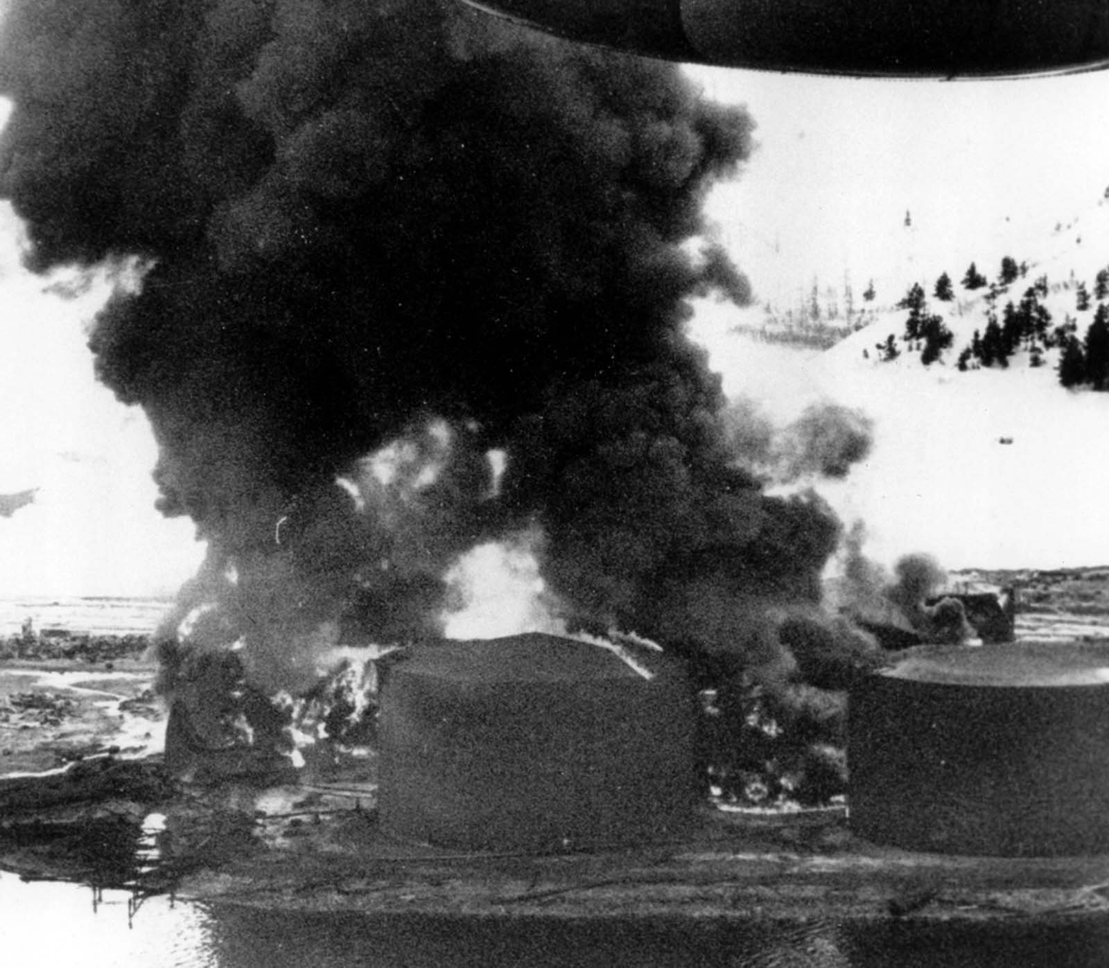 Smoke rises high into the Alaska sky from burning oil tanks in Whittier, on March 30, 1964.