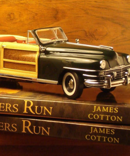 Model car atop books of Summers Run