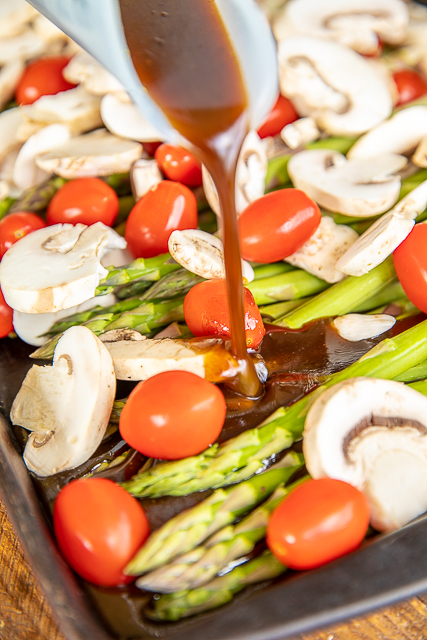 drizzling dressing on vegetables