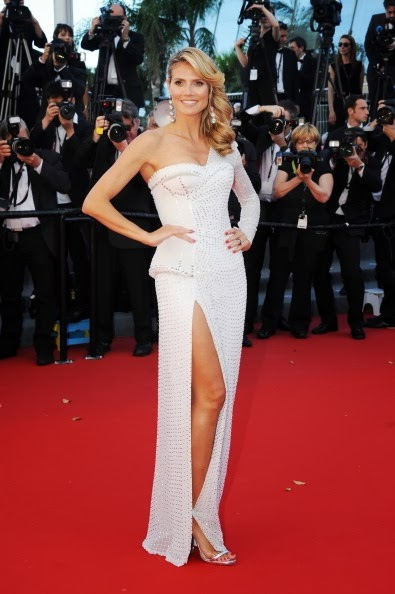 Heidi Klum in white and studded Versace in Cannes 2013