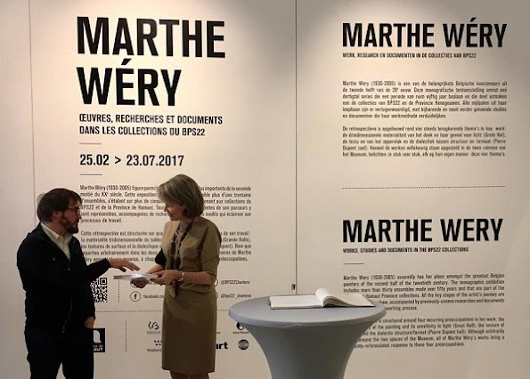 Queen Mathilde visited BPS22 Art Center in Charleroi. Queen mathilde wore Dries Van Noten dress and Delphine Nardin Gold Earrings, carried DFV Elaphe clutch