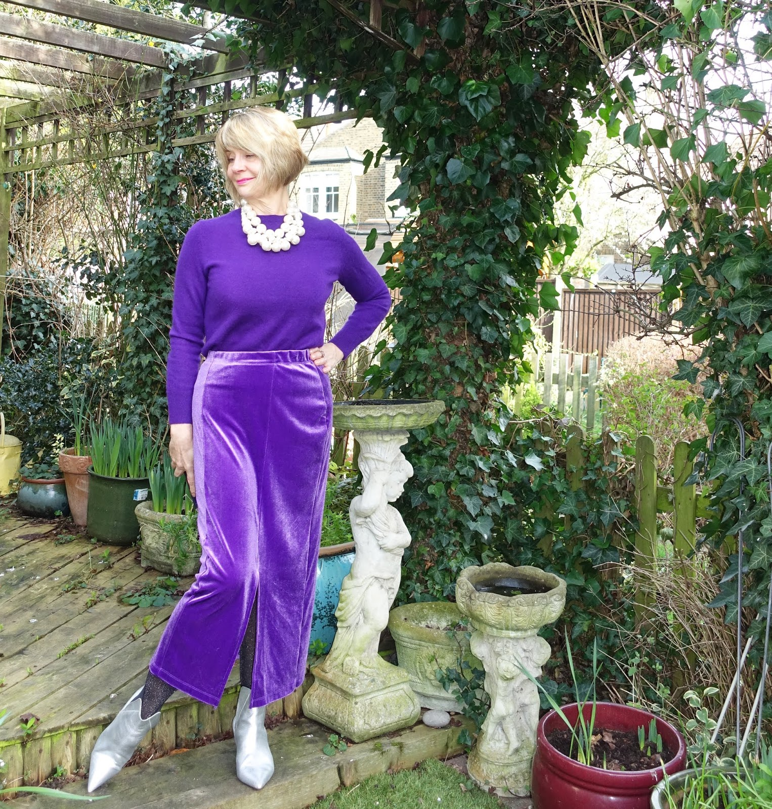 Over-50s blogger Gail Hanlon in monochrome purple with a velvet Zandra skirt from Kettlewell and silver ankle boots with chunky pearl necklaces