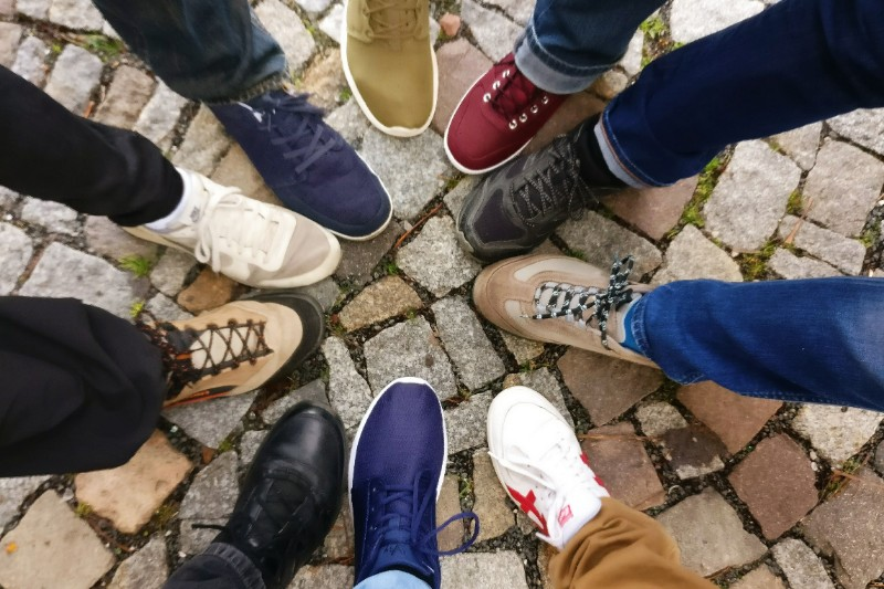 A group of guy's showing their shoes.